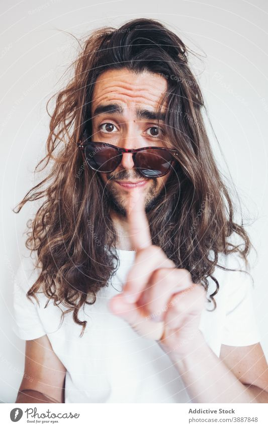 Hipster man with funny surprised face looking at camera amazed hipster long hair beard sunglasses human face expressive selfie young male grimace unbelievable