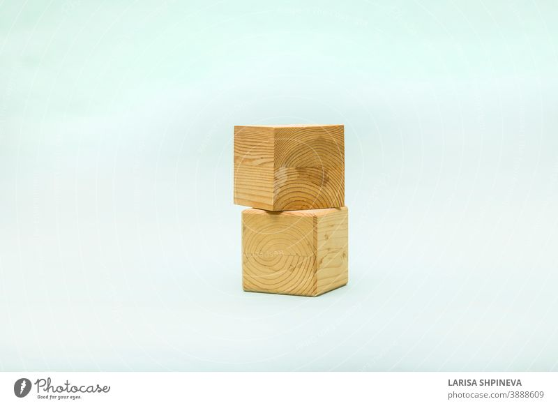 Abstract pastel background with two wooden geometric shapes. Form of wood cubes box for eco product. Empty showcase inminimal style. podium pedestal template