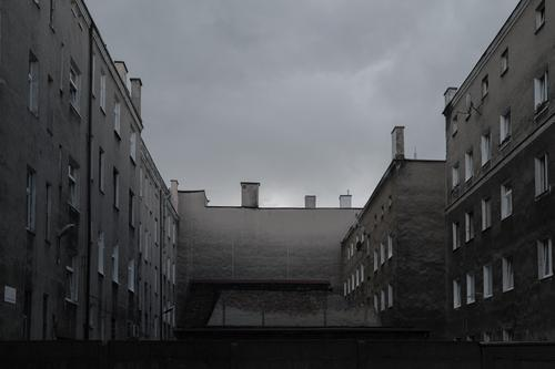 House facades in the backyard - grey and monotonous Building House (Residential Structure) Apartment Building apartment building Backyard arm precarious