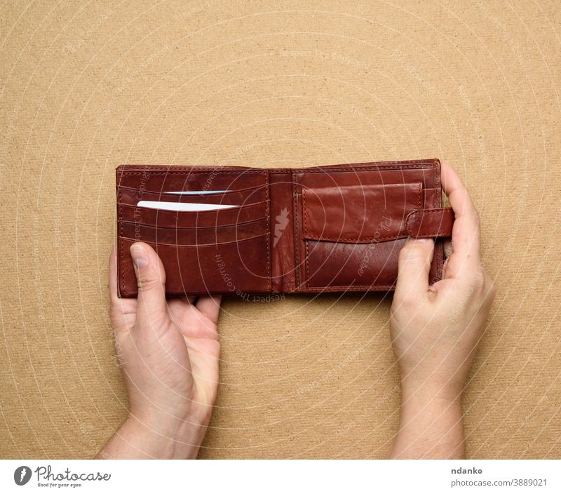 two female hands hold brown leather open wallet for cash business background holding card caucasian pocket finance money person empty purse shopping credit