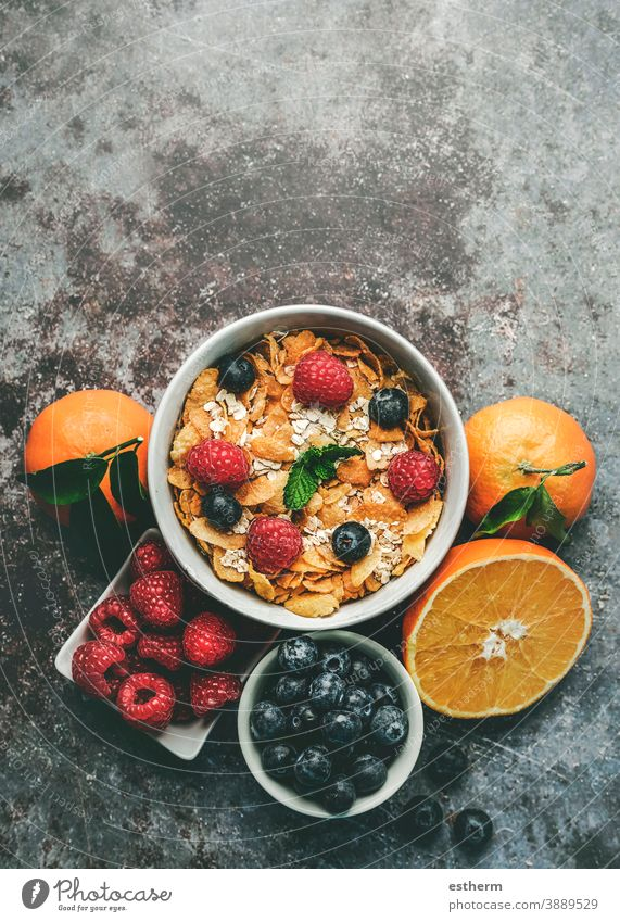 Healthy breakfast. Bowl with cereals, raspberries and blueberries next to oranges healthy breakfast raspberry fitness fruit nature freshness crunchy mint ripe