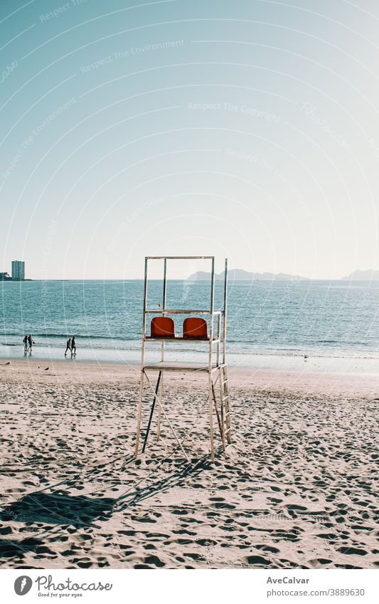 Baywatch chairs on the beach in Spain during summer sky vacation water lifeguard tower travel ocean america us baywatch blue beautiful sand tour tourism