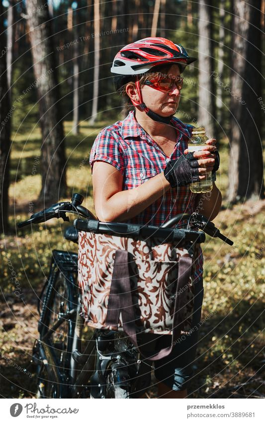 Active woman spending free summer vacation time on a bicycle trip in a forest joy freedom fall recreation adventure enjoy forest landscape forest trees