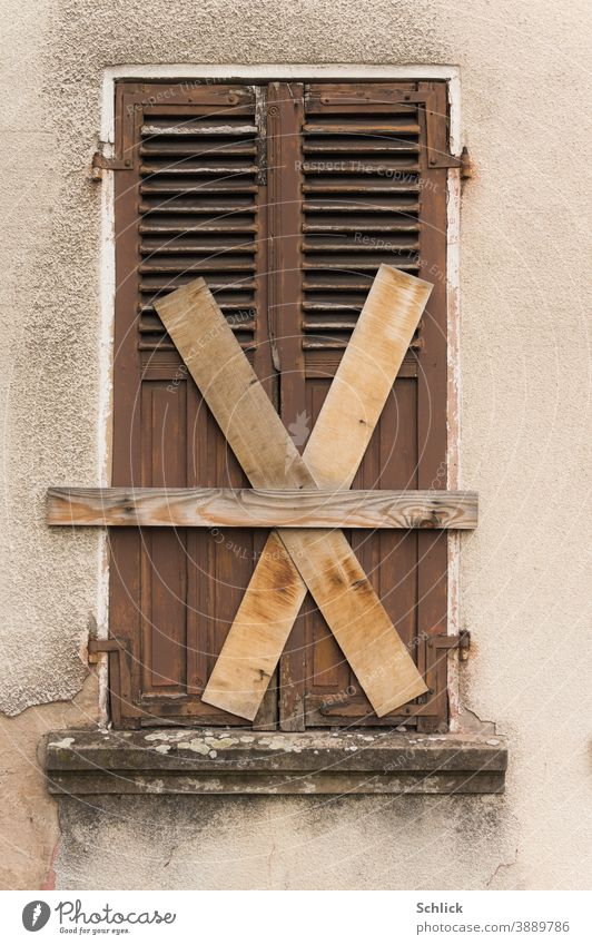 Totally too closed old wooden shutters with boards nailed crosswise Wooden folding shutter Old Closed criss-cross X dilapidated forsake sb./sth. Uninhabited