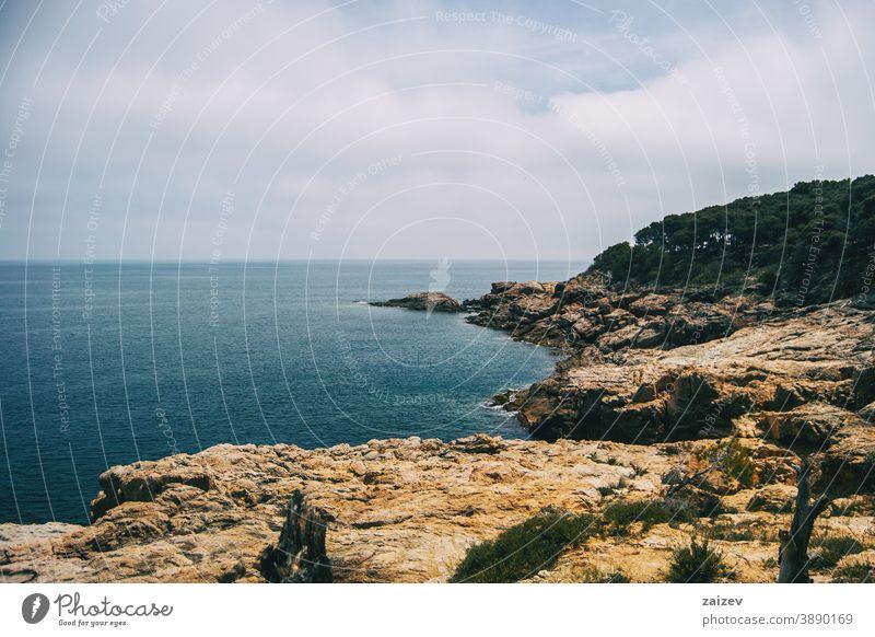Landscape of the Costa Brava in Catalonia, Spain. With a blue sea costa brava calella de palafrugell llafranc tamariu catalonia spain without people outdoor