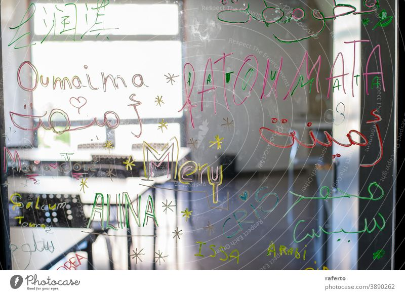View of an empty classroom from the glass door desk chair school education nobody table blackboard training interior seat indoor study lecture learn university