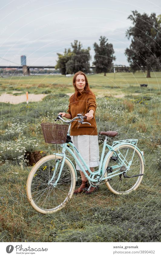 Woman with bicycle in the nature Love of nature Bicycle Cycling tour Sustainability sustainability vintage Vintage girls Vintage style Picnic Freedom
