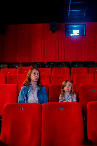 Visit to the cinema Movie hall Cinema Child Infancy cinema visitors Movie theater seat Leisure and hobbies Culture Red Light Row of seats Dark Film industry fun