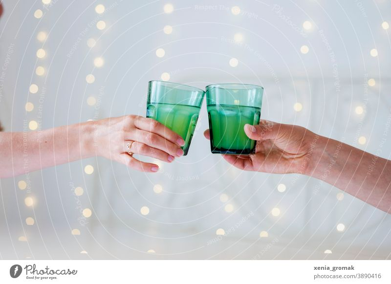 Two glasses Toast Public Holiday celebrations Christmas & Advent New Year's Eve Sparkling wine Glass Green Party Festive Friends