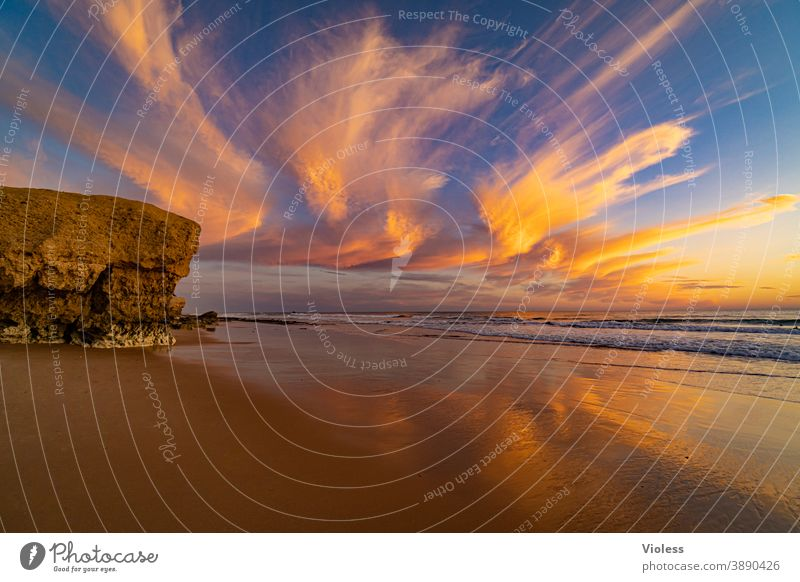 Clouds spectacle at the coast of the Algarve II Sunset gale Surf Discover Vale Parra Relaxation Portugal Sand Water Beach Landscape Romance Freedom Sunbeam Rock
