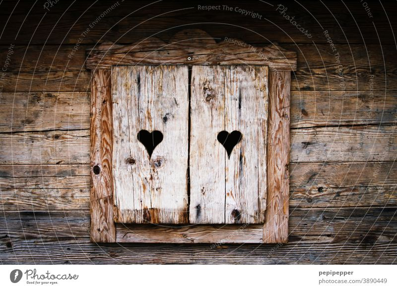 old wooden hut with closed heart shutters Wooden hut Hut Huts hut fun Après ski Winter Cold Mountain Winter vacation Alps Vacation & Travel Deserted Tourism