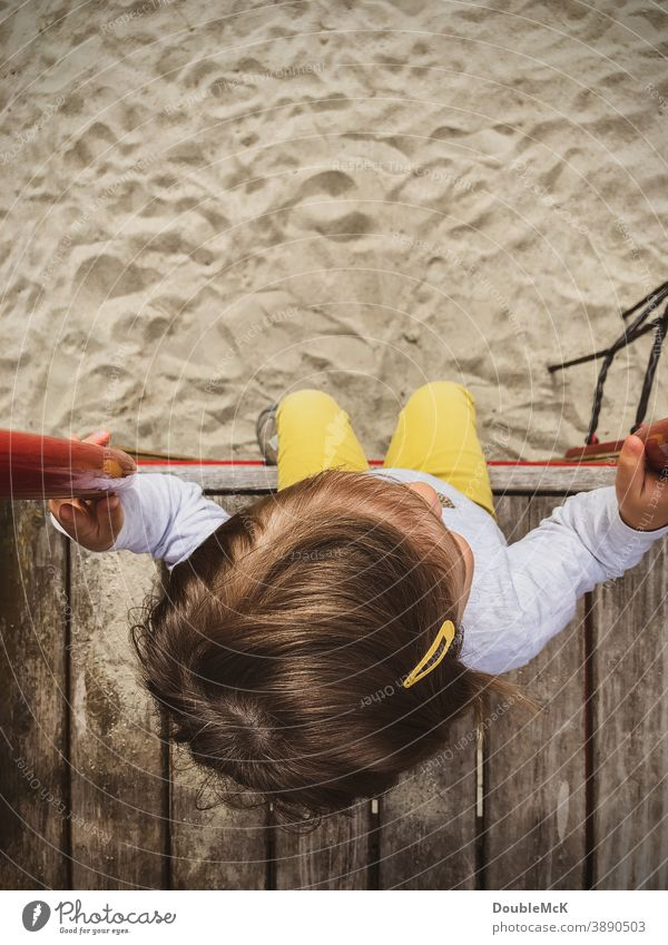 Girl sitting on platform of a playground Child Toddler Playing Infancy Colour photo Joie de vivre (Vitality) Movement Human being Exterior shot Joy