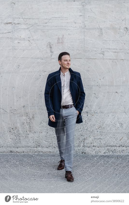young man, business, outside in front of concrete wall masculine more adult Young man Man Friendliness Smiling Business Businessman Happiness Concrete
