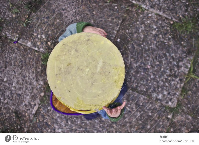 Stick your head in the bucket Child Toddler Hide play hide and seek Playing Joy Infancy 1 - 3 years Happiness Bucket from on high washed concrete Yellow amused