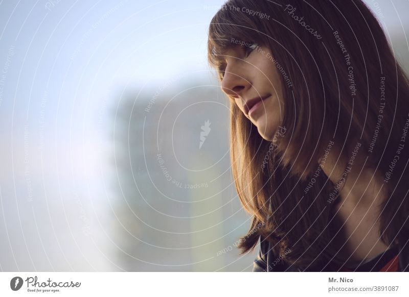 Dreamy view out of the window Young woman Head Window Long-haired Brunette Observe Wait Patient Optimism pretty Sadness Meditative Hope Window pane Dreamily