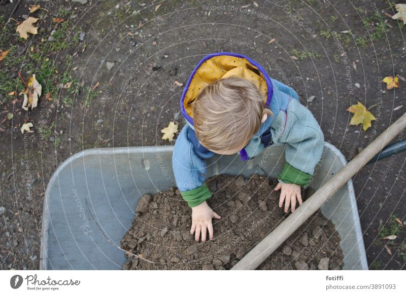child with wheelbarrow Child Wheelbarrow Garden Gardening out helping hand join in Hand Earth Comprehend right in the middle Nature Gardener Human being Seeds