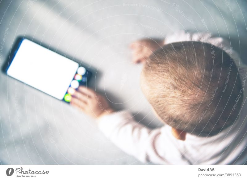 Toddler on mobile phone Baby Cellphone Hand peril distraction Parenting Harmful Responsibility