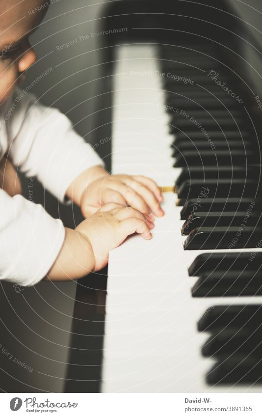 Toddler at the piano Child explore Music Musical instrument Piano Cute Playing inquisitorial cautious inquisitive Culture Parenting Play piano Fingers hands