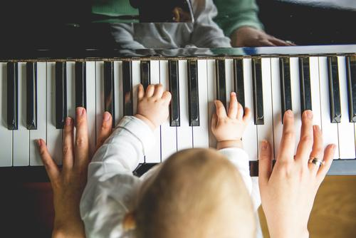Mother and child make music together at the same time Make music Child Musical instrument early musical education Parenting Family Playing Piano hands in common