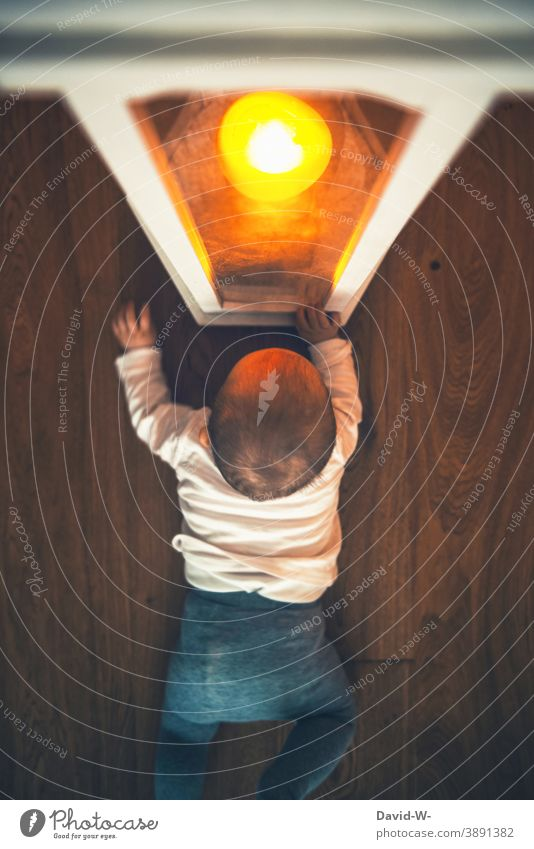 Child fascinated by candlelight in the lantern Toddler Baby Candlelight Fire attractive spellbound Light inquisitorial peril Lantern shoulder stand Illuminate