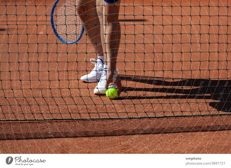 Tennis Player Taking a Ball from the Ground tennis player sportsman racket take ball court ground playground field clay competition activity service game set
