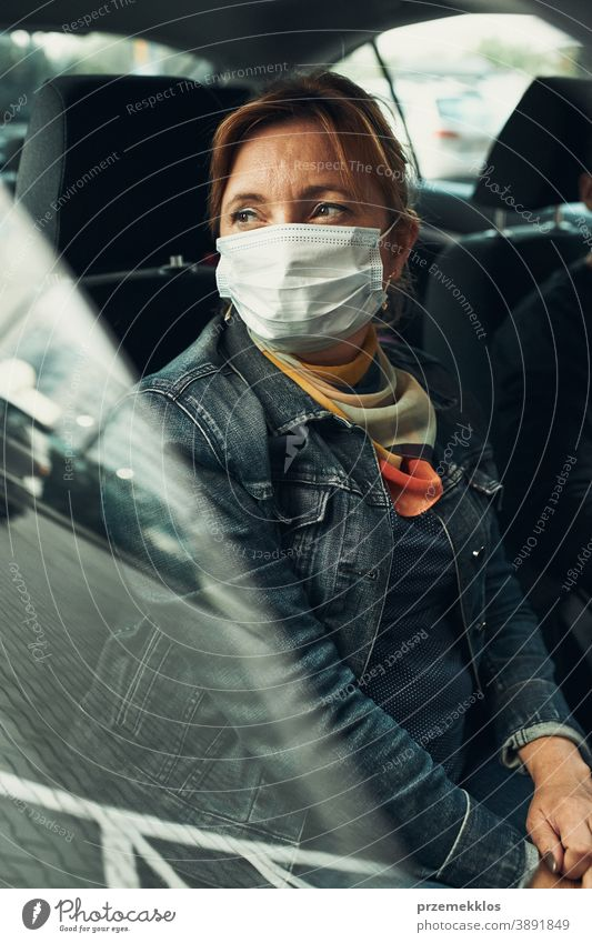 Woman sitting in a car wearing the face mask to avoid virus infection caucasian covid-19 lifestyle outbreak pandemic woman protection protective quarantine care