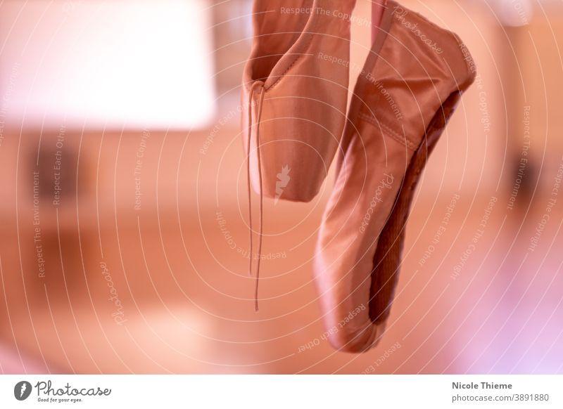 Ballet shoes - Pointe shoes hang on ballet bar in dance studio ballet shoes pointe satin footwear art classic ballerina elegant elegance pair dancer gold silk