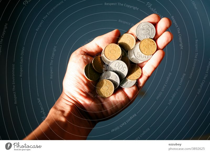 hand holding 500 coins indonesian rupiah Hand Coin Money Financial Industry Cent Paying Save Loose change Economy Financial institution investment savings