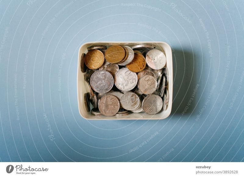 indonesian rupiah coins on white box Coin Box Money Money box Save Colour photo Financial Industry Thrifty Financial institution Economy Business Income