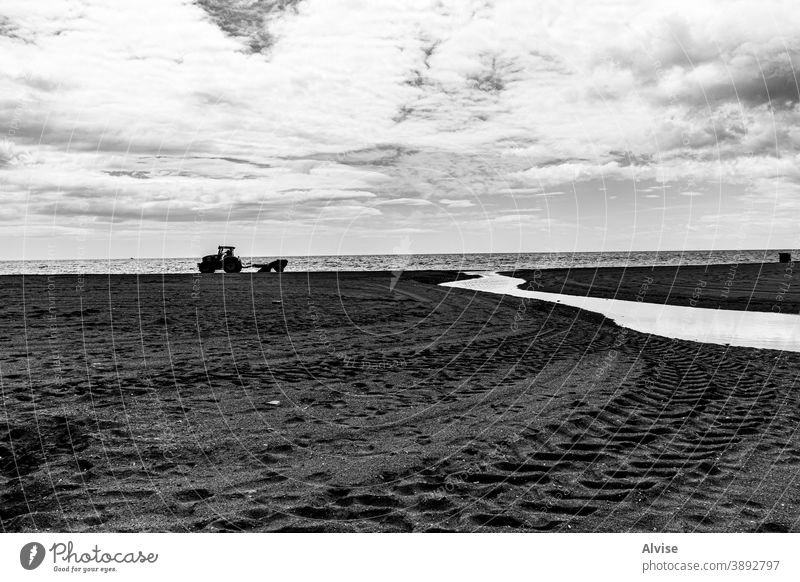 winter beach with tractor, sand and stream spain sea travel coast mediterranean estepona water vacation tourism sun andalusia nature landscape coastline europe