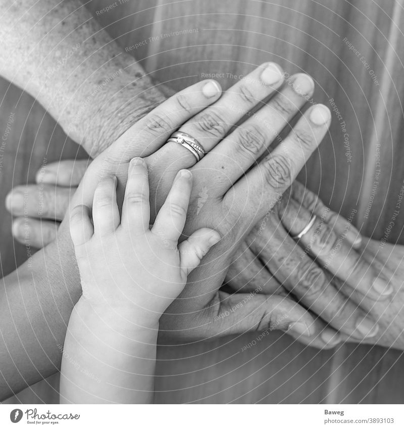 Hands of four generations old age baby parents family finger woman joy former times community luck grandmother hand hands child power love closeup newborn