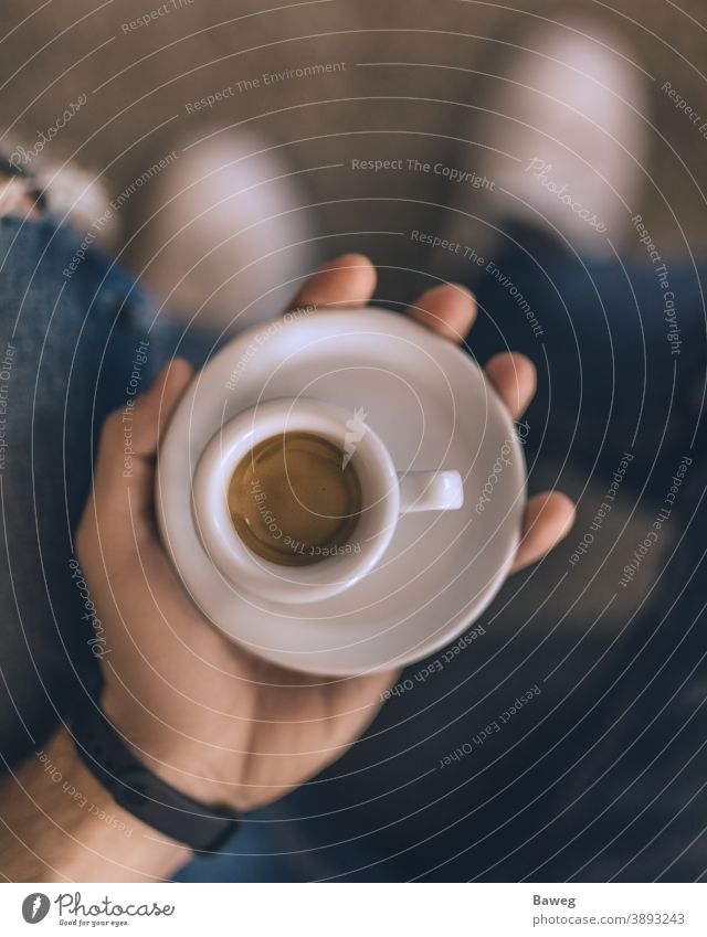 Man holding espresso while sitting on the couch. At home Body Breakfast Brown Brown tone Chill Coffee Colors Cups Depth of Field Enjoyer Enjoyment Fun Hand