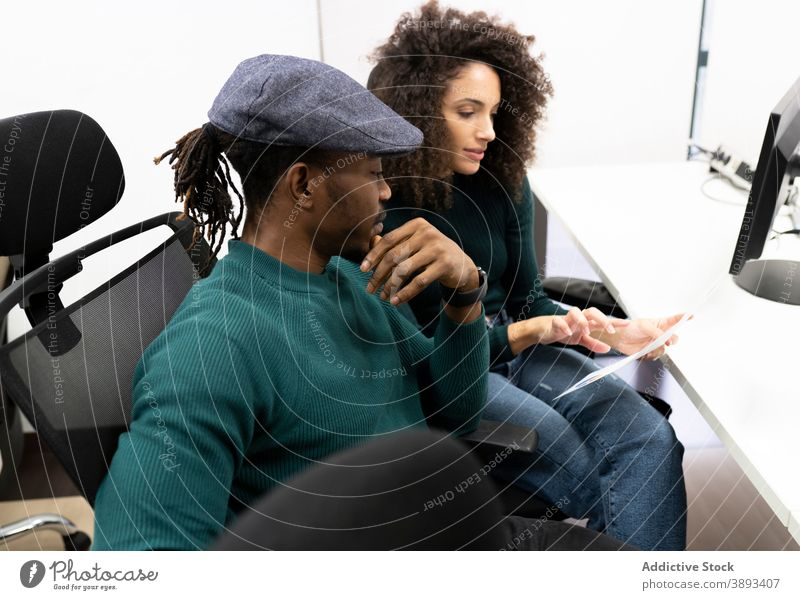 African American coworkers discussing business results in office colleague diagram casual positive together workplace african american black communicate