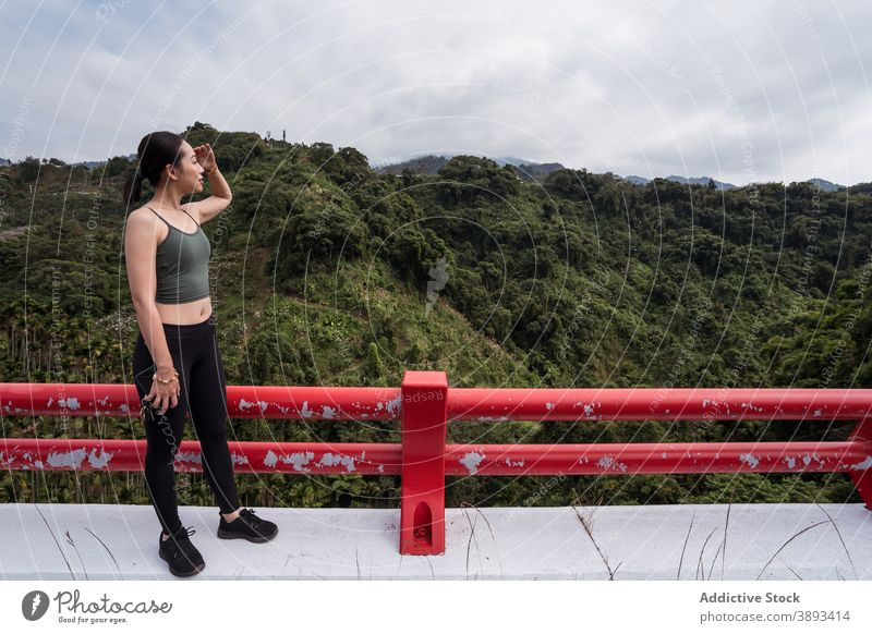 Asian woman enjoying view of mountain valley viewpoint highland traveler admire observe summer explore female ethnic asian taichung taiwan amazing green scenery