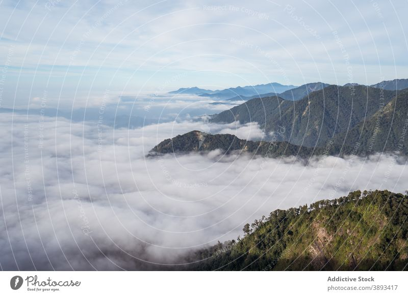 Amazing view of mountains surrounded by clouds landscape breathtaking sunny scenery amazing highland range ridge yuanzui mountain taiwan cloudy sky hill nature