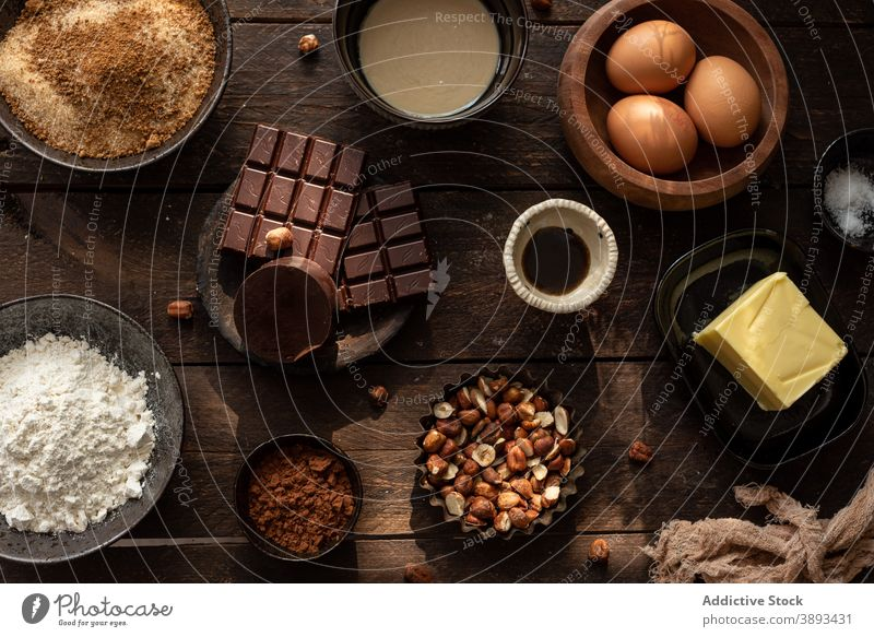 Ingredients for pastry recipe with chocolate and hazelnuts ingredient sweet various set food prepare bake cuisine culinary butter egg cocoa flour assorted