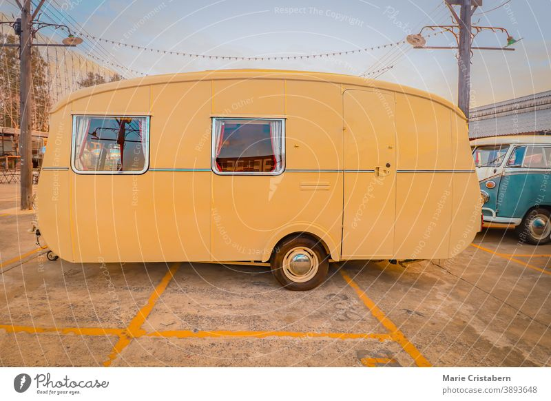 Yellow vintage RV, showing concept of travel and alternative lifestyle road trip yellow motorhome freedom motor home mobile home rv living transportation rustic