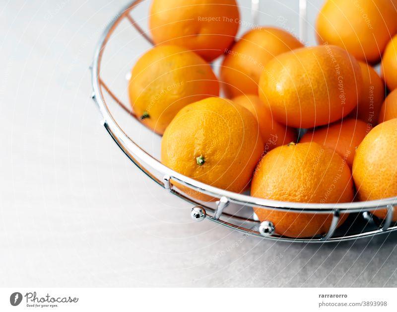 Group of tangerines. Citrus fruit. Orange color of the peel. mandarin clementine group orange citrus health care basket metal fruit bowl ripe tasty sour round