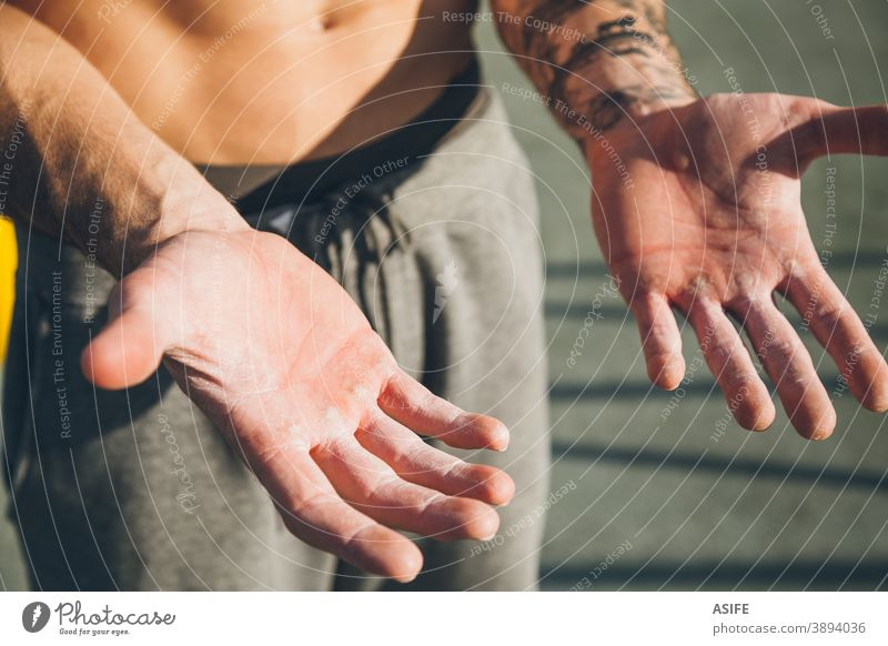 Hands with callus of a young calisthenics sportman hands callosity hardness magnesium powder chalk athlete muscles strength gymnastics street freestyle body