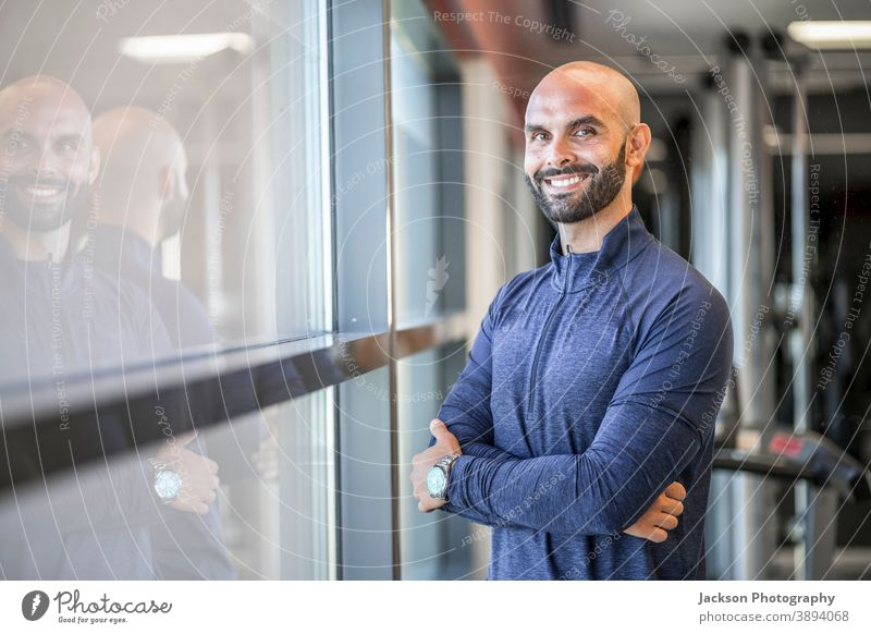 Portrait of confident, well built man at the gym trainer personal smile copy space bearded man businessman handsome modern instructor coach active adult athlete
