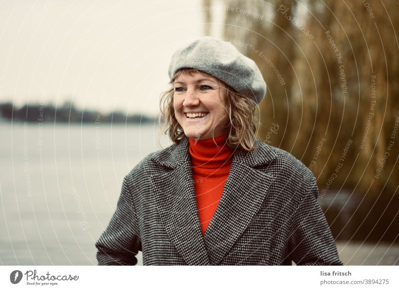 LAUGH - AUTUMN - CAP - CHEERFUL Woman 30 years old Blonde Curl Hair and hairstyles Beret Headwear Happiness Contentment Laughter fortunate Water Alster