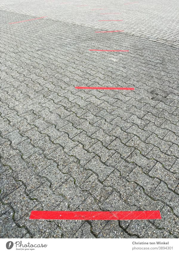 Keep your distance...  red lines as markers on grey stone pavement | corona thoughts keep sb./sth. apart Marker line Street corona virus Corona Pandemic gap