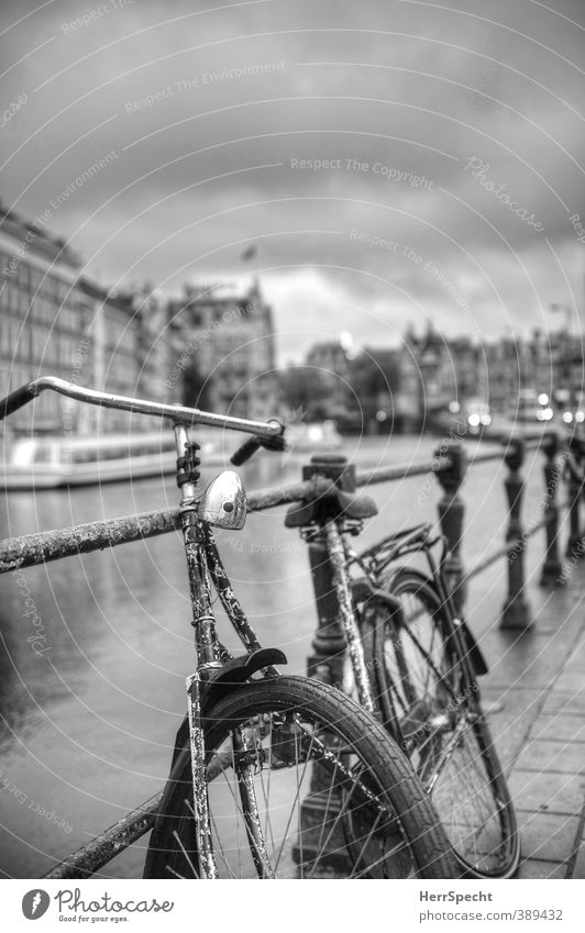 Old Loneliness Clouds House (Residential Structure) Building Bicycle Wait Esthetic Historic Rust Bridge railing Nostalgia Parking Old town Bad weather