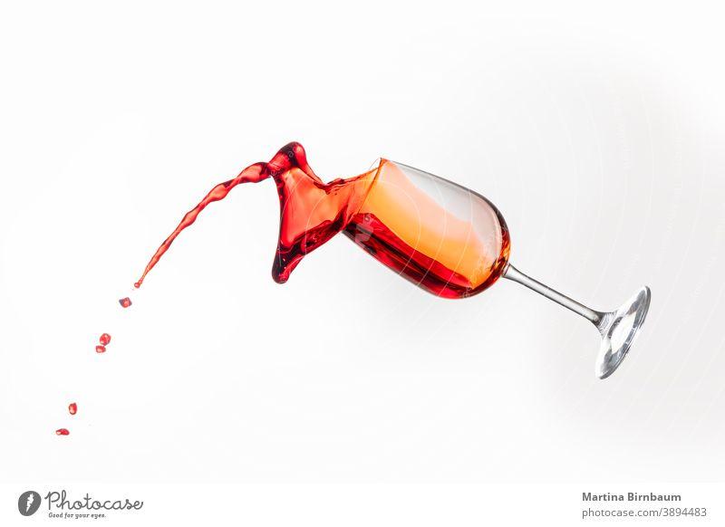 Splashing red wine in a glass on white background splash gourmet object rose splashing liquid glassware merlot celebration drink goblet pour celebrate motion