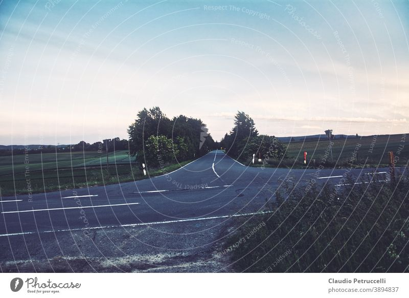 Crossroads and town entry in the country Street cross Country road crossroad Landscape Place Avenue Asphalt fields Tree Exterior shot Colour photo