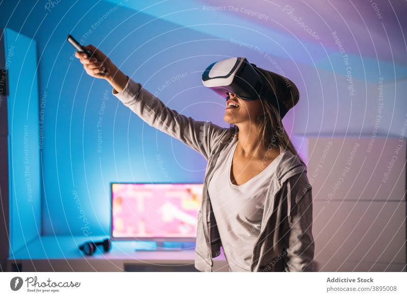 Amazed woman experiencing virtual reality in VR goggles vr excited play game videogame experience amazed shock female gamer gadget entertain innovation glasses