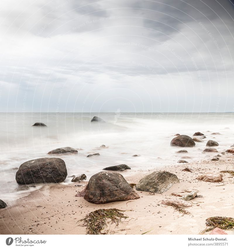 Rocks on the sandy beach Baltic Sea baltic Ocean sea Lake wave woge Water water Sand Beach White white Blue blue Green green Sky sky cloud tranquillity calm