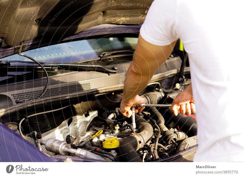 repairman is fixing the car engine checking a car engine eninge repair engine damage car maintenance car mechanic motorcar mechanic fixing an engine car repair