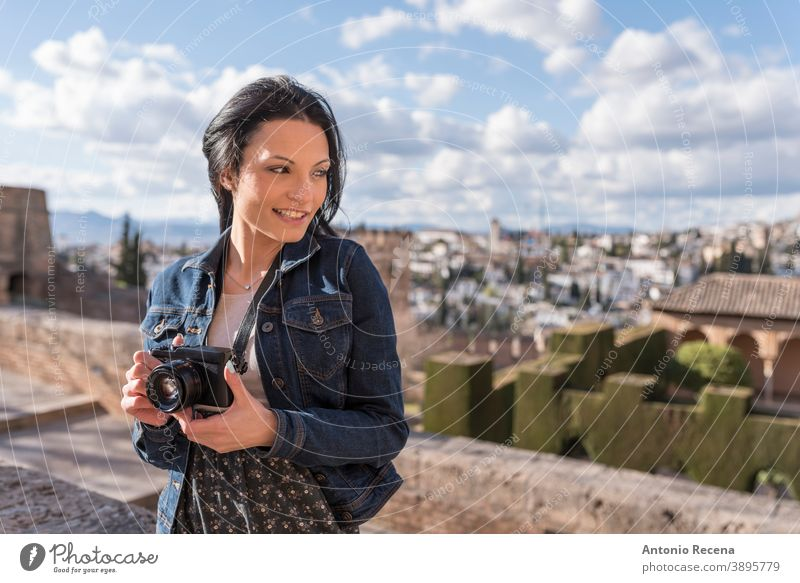 Young woman with camera in Granada, Spain granada tourist pretty 30s 30-35 years people one woman only person women lifestyles attractive caucasian La Alhambra