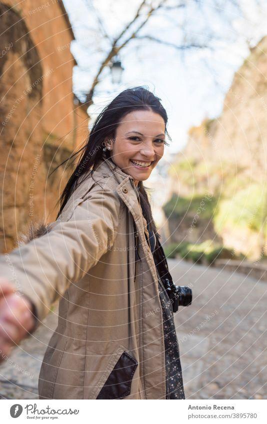 "Young tourist holding boyfriend hand in ""Cuesta del rey chico"" near to ""La Alhambra"" Granada, Spain woman granada pretty 30s 30-35 years people one woman only"